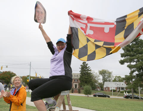 Stina Pillion roots for daughter Katie Pillion, both of Baltimore, at the Baltimore Marathon.