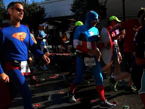 James Cozzi, aka Superman, and Nathan Beyler, aka Captain America, run the Bank of America Chicago Marathon.