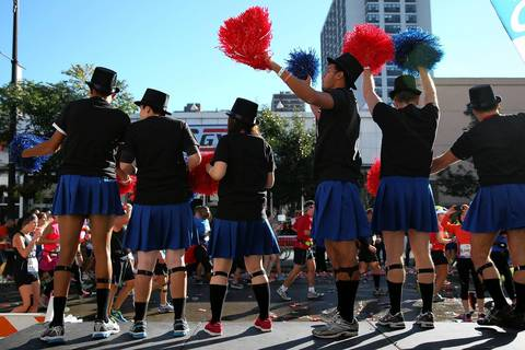 Cheerleaders support the runners on a stretch of North Broadway in the Boystown neighborhood during the Bank of America Chicago Marathon.