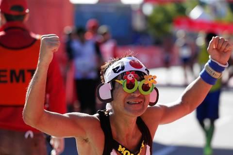 Yoshitaka Naruse, from Japan, celebrates finishing the 2013 Bank of America Chicago Marathon.