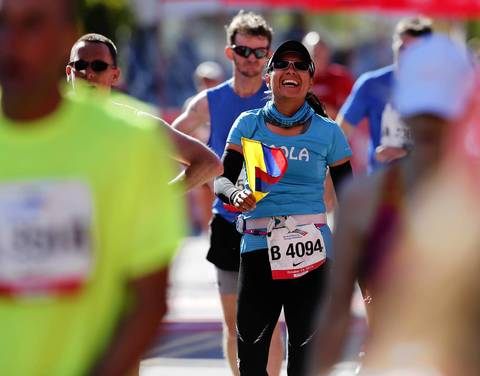 Paola Fierro, from Bogota, Colombia, celebrates after crossing the finish line of the 2013 Bank of America Chicago Marathon.