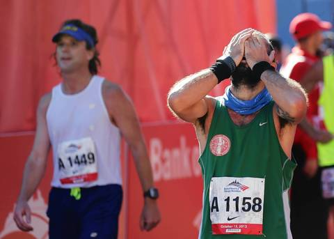 Michele Checchia, from Italy, is joyful for completing the 2013 Bank of America Chicago Marathon.