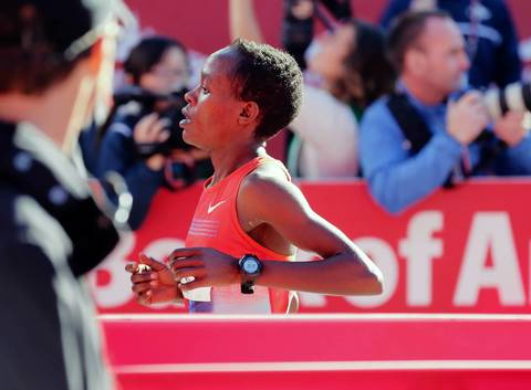 Jemima Sumgong Jelegat, from Kenya, is the second woman to cross the finish line of the 2013 Bank of America Chicago Marathon.