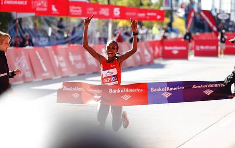 Rita Jeptoo, of Kenya, wins the women's elite division of the Bank of America Chicago Marathon.