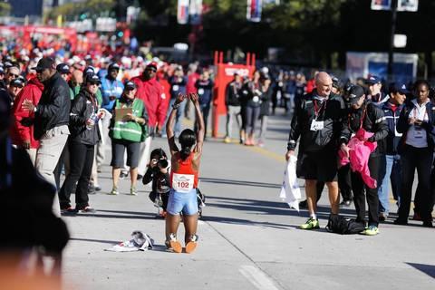 Rita Jeptoo, of Kenya, celebrates winning the women's elite division of the Bank of America Chicago Marathon.