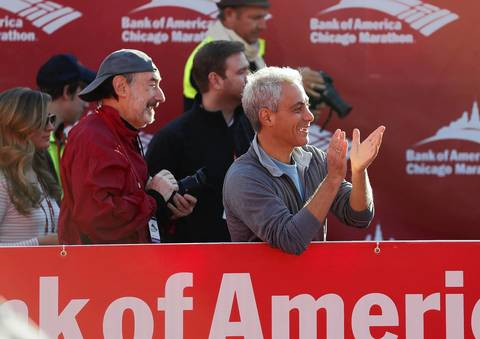 Chicago Mayor Rahm Emanuel cheers on the finishers in the women's wheelchair division of the Bank of America Chicago Marathon.