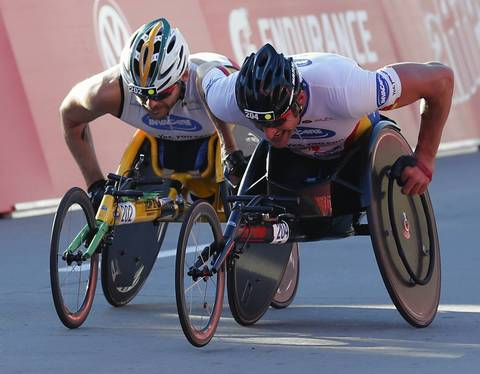 Ernst Van Dyk, right, sprints to the finish past Kurt Fearnley to win the men's wheelchair division at the 2013 Bank of America Chicago Marathon.