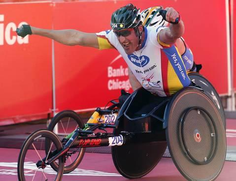 Ernst Van Dyk celebrates winning the men's wheelchair division at the 2013 Bank of America Chicago Marathon.