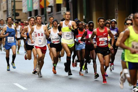 A pack of front runners run down Grand Avenue.