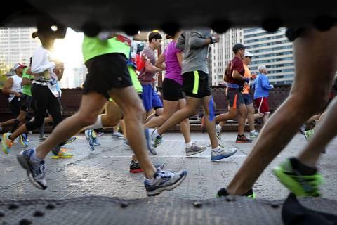 Runners cross the State Street bridge.