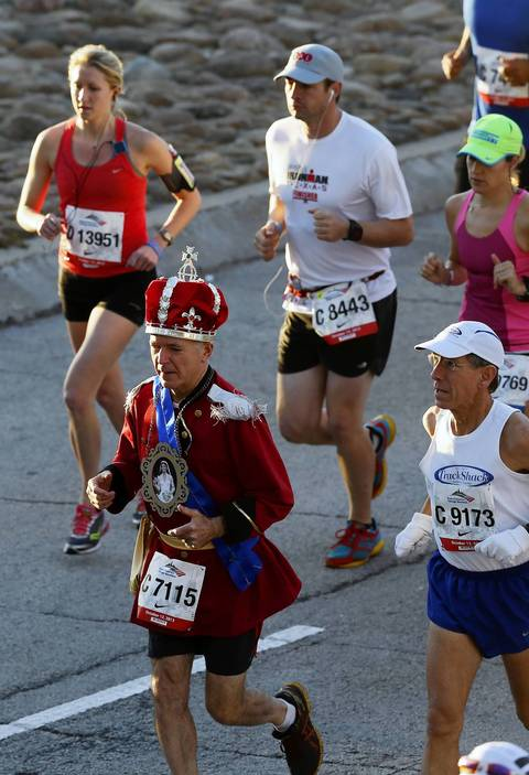 Richard Webster, wearing a crown, from Boston, Mass., begins the 2013 Bank of America Chicago Marathon.