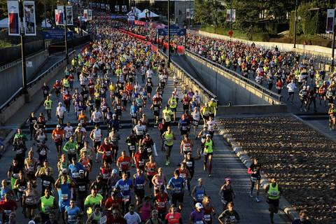 Runners head north on Columbus Drive at the start of the 2013 Bank of America Chicago Marathon.