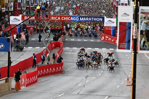 Wheelchair racers take off in the Bank of America Chicago Marathon.