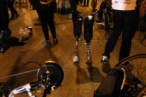 The prosthetic legs of Brian Pomerville stand on the sidewalk on Jackson Boulevard near gate #1 at the Chicago Marathon. Pomerville ran with Achilles Freedom Team of Wounded Vets.