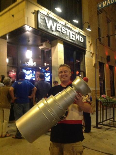 I got sick of seeing all the cheesy tin-foil Stanley Cups and made this one myself. It's pretty secure with nuts, bolts, and a couple tubes of superglue. Cost? $20. Here I am in front of the best Hawks bar in the city!