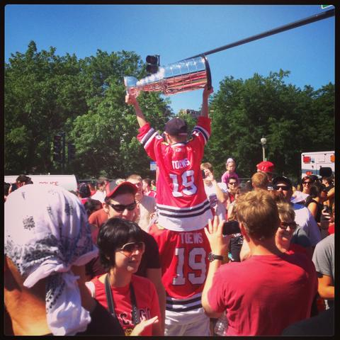 Toews (kid) hoists the Stanley Cup at the Blackhawks Parade.