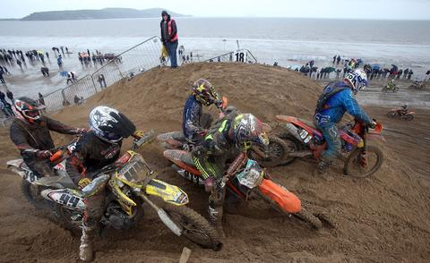 SOMERSET, UNITED KINGDOM - OCTOBER 13:  Riders compete during the main solo race of the 2013 RHL Weston annual beach race in Weston-Super-Mare on October 13, 2013 in Somerset, United Kingdom.  The three-hour endurance race, one of the largest of its kind in the UK, saw hundreds of riders competing on a course marked out on the beach, with man-made jumps and sand dunes being constructed to make the course tougher.