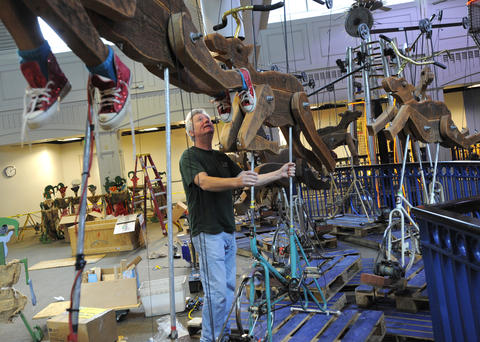 Reindeer made from wood are installed at the exhibit.