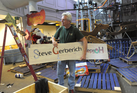 """Artist Steve Gerberich installs his """"Holiday Springs & Sprockets"""" exhibit at Port Discovery."""