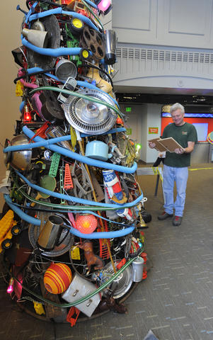 A Christmas tree made from hundres of items.