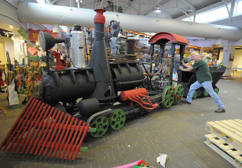 A train made of recycled items is part of the exhibit.