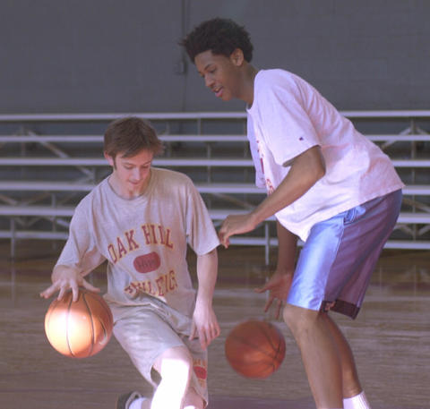Carmelo Anthony plays dribble tag with Joe Law in gym class at Oak Hill Academy.