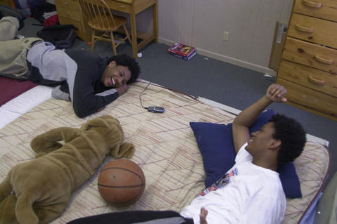 Carmelo Anthony (left) talks with his roommate Justin Gray after school in their dorm room at Oak Hill Academy.