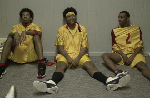 Carmelo Anthony (center) talks with Justin Gray (left) and Chadd Moore (right) in the boys locker room at Oak Hill Academy.