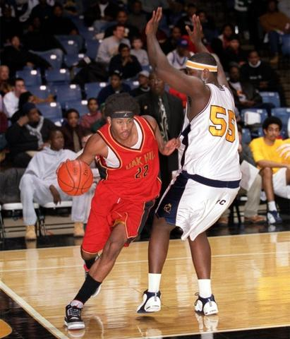 Oak Hill's Carmelo Anthony drives down the baseline as he is defended by Towson Catholic's Byron Joynes during the 2002 State Farm Round Ball Challenge at the Towson Center.