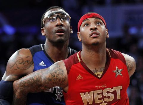 Carmelo Anthony boxes out Amare Stoudemire during the 2011 NBA All-Star Game in Los Angeles.