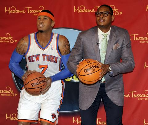 Carmelo Anthony poses next to his wax likeness at the unveiling at Madame Tussauds New York.
