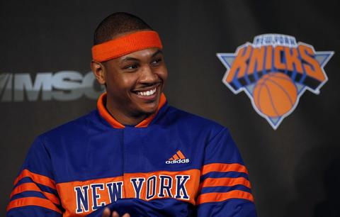 Carmelo Anthony smiles at a news conference where he was introduced as the newest member of the Knicks after being acquired in a trade from the Denver Nuggets.