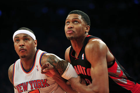 Carmelo Anthony boxes out fellow Baltimore native Rudy Gay in a game against the Toronto Raptors last season.