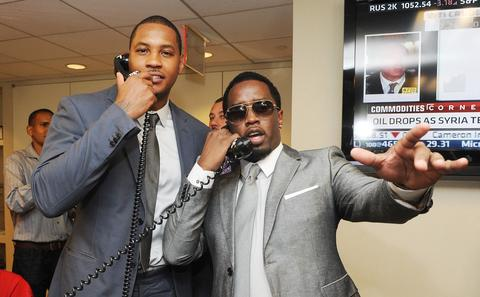 "Carmelo Anthony and rapper/producer Sean ""Diddy"" Combs participate in a charity event."
