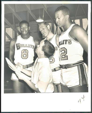Publicitor Jerry Krause checks heights with the Bullets' Walt Bellamy, Don Kojis and Bill McGill.