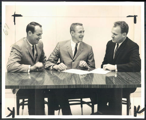 Coach Bob Leonard (left) and general manager Paul Hoffman (right) look on as former West Virginia University star Rod Thorn signs with the Bullets.