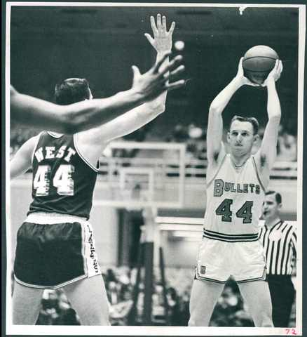 Rod Thorn looks to inbound to Walt Bellamy as the Lakers' Jerry West defends.