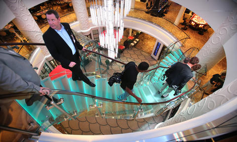 Michael Meekins (left), a senior director at Port Canaveral, in the main atrium on the new Norwegian Cruise Lines ship Breakaway, making its first docking at Port Canaveral, Tuesday, October 15, 2013. (Joe Burbank/Orlando Sentinel) B583258058Z.1