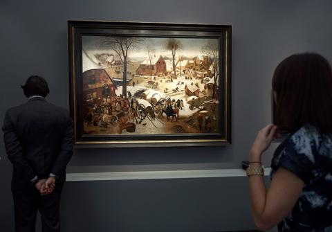 "Visitors view ""The census at Bethlehem"", a newly discovered work by Pieter Brueghel the Younger, during a private viewing of the Frieze Masters 2013 art fair in London October 15, 2013. Frieze Masters, showing works for sale from 130 galleries from around the world, opens Thursday and runs until October 20."