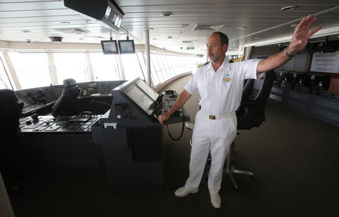 Ship Captain Evans Hoyt talks to reporters at the bridge on the new Norwegian Cruise Lines ship Breakaway, making its first docking at Port Canaveral, Tuesday, October 15, 2013. (Joe Burbank/Orlando Sentinel) B583258058Z.1