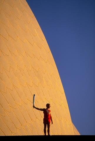 The 2000 Sydney Olympic Games Torch outside the Sydney Opera House.