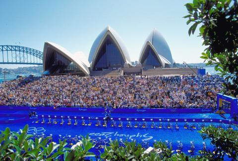 Simon Whitfield of Canada sprints home to win Gold in the Mens Triathlon at the Sydney Opera House during Day Two of the Sydney 2000 Olympic Games in Sydney, Australia. Stewart finished in sixth place in the event.