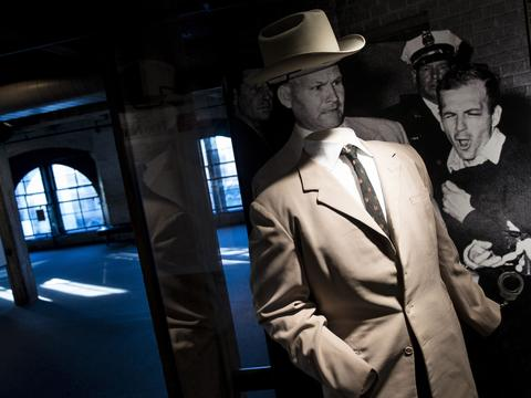 The suit worn by Dallas Homicide Detective Jim Leavelle is seen in front of a photo of the murder of Lee Harvey Oswald by Jack Ruby in the Sixth Floor Museum formally the site of the Texas School Book Depository October 8, 2013 in Dallas, Texas. The sixth floor of the Dallas County Administration Building now houses the Sixth Floor Museum which is dedicated to the history behind the assassination of US President John F. Kennedy. November 22 will mark the 50th anniversary of the assassination of JFK in Dallas's Dealey Plaza.