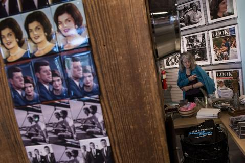 Magnets of Jacqueline Kennedy and John F. Kennedy are seen as a woman walks through the gift shop of the Sixth Floor Museum October 9, 2013 in Dallas, Texas. The Sixth Floor Museum is dedicated to the history behind the assassination of US President John F. Kennedy. November 22 will mark the 50th anniversary of the assassination of JFK in Dallas's Dealey Plaza.