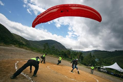 A participant glides towards the landing pad during the World Paragliding Series on October 17, 2013 in Kota Kinabalu, Sabah, Malaysia. Sabah is hosting the final leg of the World Paragliding Series which is sanction by both the Federation Aeronautique Internationale (FAI) and Malaysia Sports Aviation Federation (MSAF) with 61 participants from all over the world.