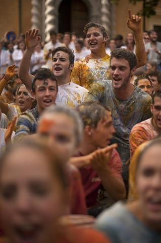Freshers of the Faculty of Medicine are covered with food during a hazing at the University of Granada, in Granada on October 17, 2013.
