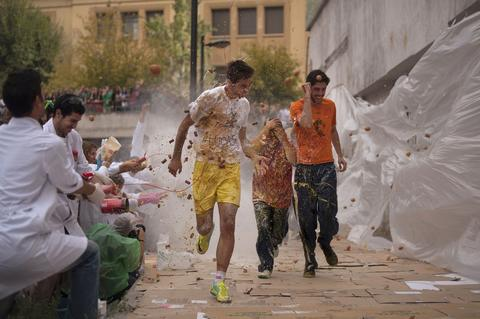 Medical students throw food at freshers of the Faculty of Medicine during a hazing at the University of Granada, in Granada on October 17, 2013.