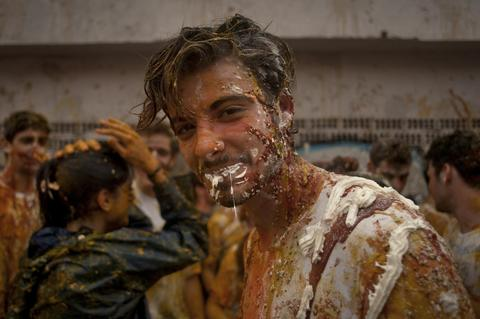 A fresher of the Faculty of Medicine is covered with food during a hazing at the University of Granada, in Granada on October 17, 2013.