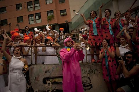 "Medical students dressed up as characters of the cartoon ""the Flintstones"" take part in a hazing at the Faculty of Medicine of the University of Granada, in Granada on October 17, 2013."