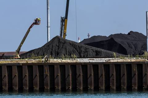 The South Side environmental activists are taking a boat tour to see giant mounds of petroleum coke piling up along the Calumet River in Chicago on Monday, Sept. 9, 2013.